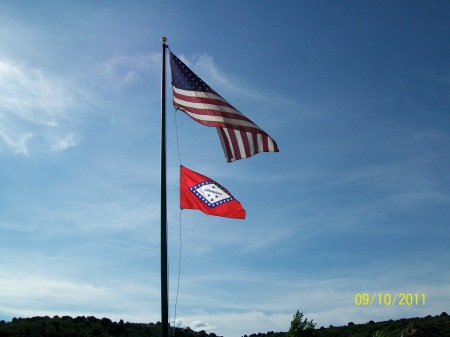 U.S. and Arkansas flags flying from the same pole. Photo from Mountain Meadows Massacre Descendants.